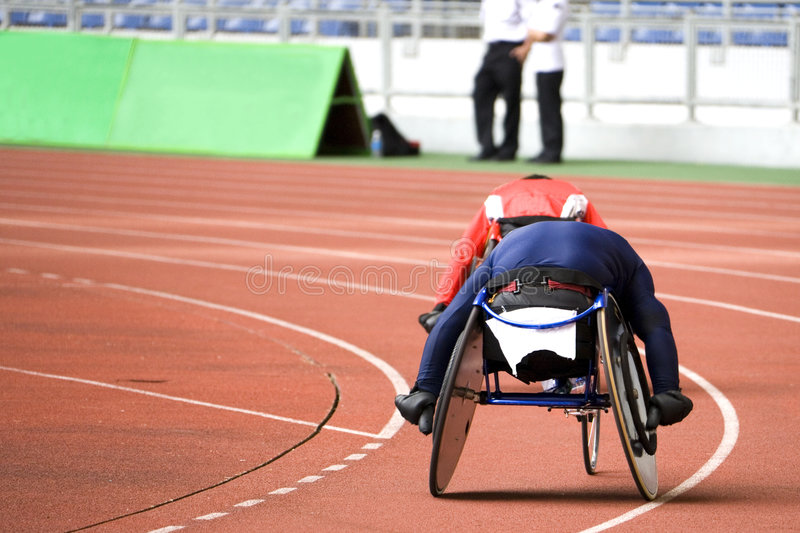 Wheel Chair Race. Image of disabled athletes competing in a wheel chair race royalty free stock photo