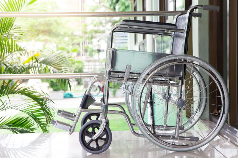 Wheel chair with sunlight. On a natural background stock photo