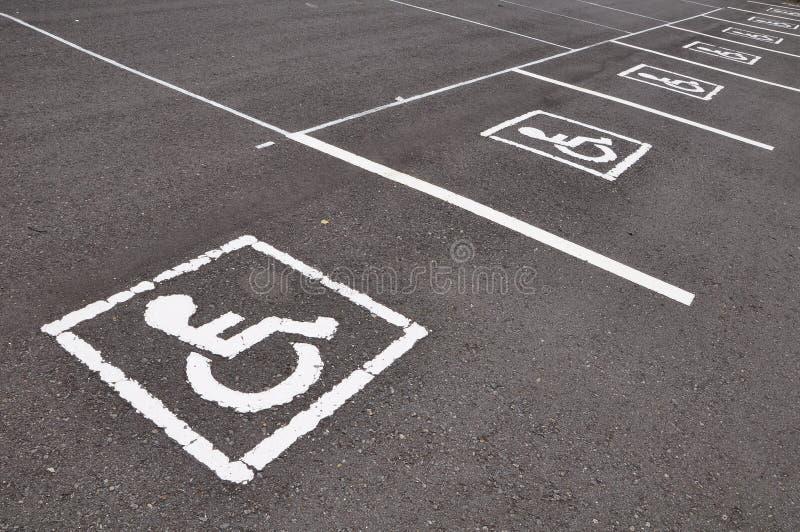 Wheel chair symbol. With asphalt road stock photos