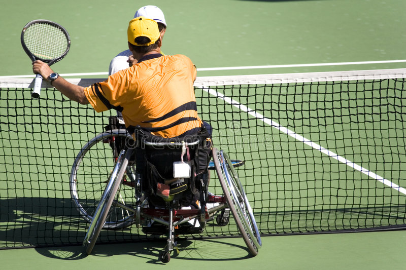 Wheel Chair Tennis for Disabled Persons (Men) royalty free stock image