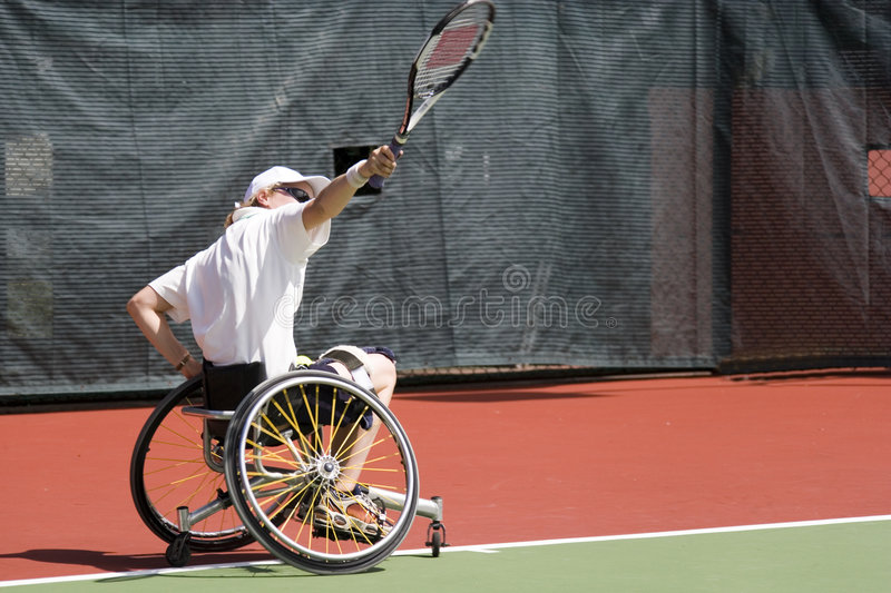 Wheel Chair Tennis for Disabled Persons (Women) stock photos