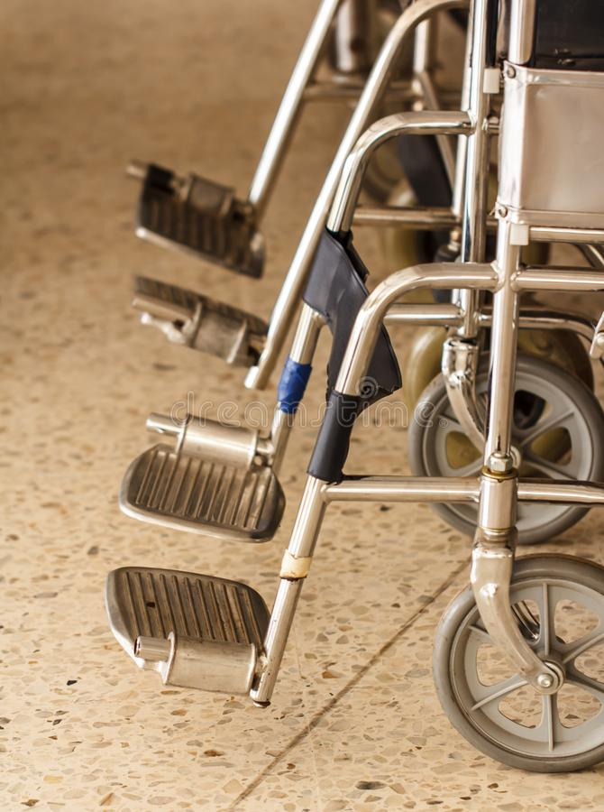 Wheel chair wheel. Wheelchair in a hospital ward, patients royalty free stock photography