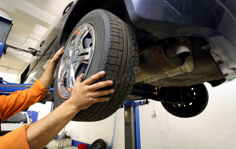 Download Wheel change stock photo. Image of repair, concentration - 6171916