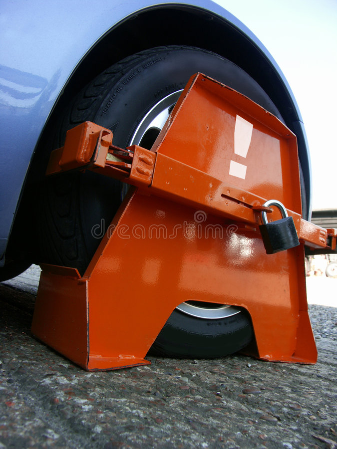 Wheel Clamp close. Wheel Clamp on car close up royalty free stock photography