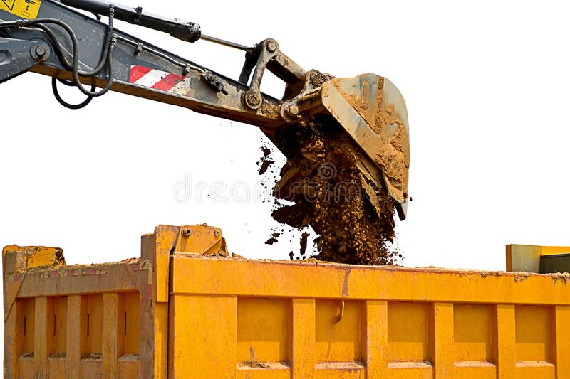 Wheel excavator and dump truck with white background, wheel excavator in construction site, soil royalty free stock photography