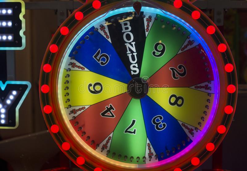 Wheel of fortune. Colorful gamble wheel with text of Bonus and a red light royalty free stock image