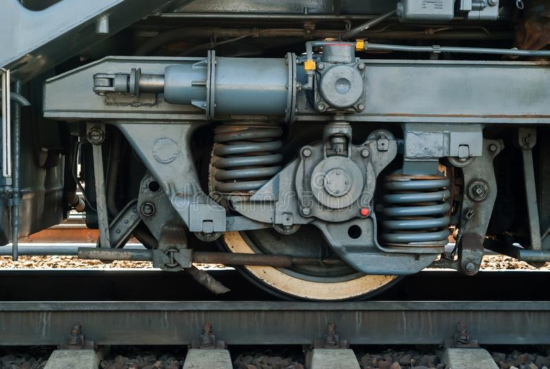 Wheel and fragment of truck frame of modern locomotive stock images
