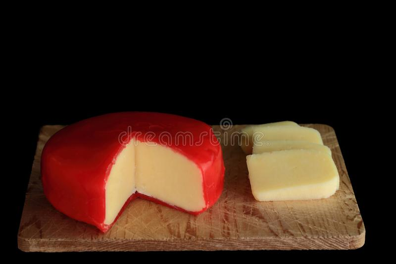 Wheel of Gouda Cheese and slices stock images