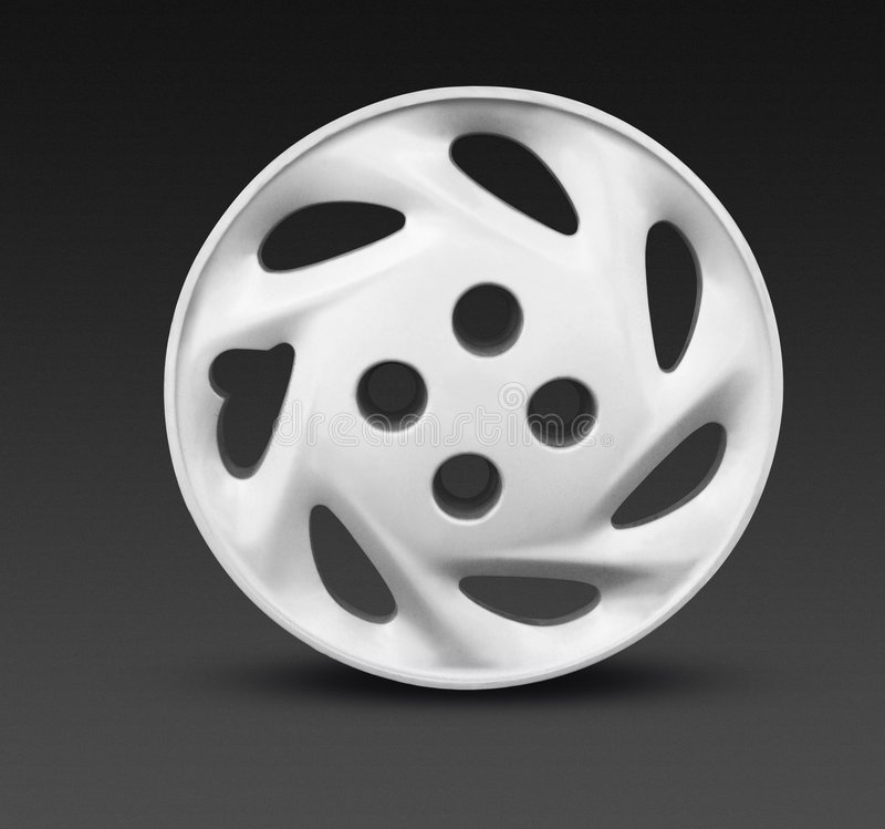 Wheel hubcap rim. Metallic alloy hubcap rim wheel royalty free stock photos
