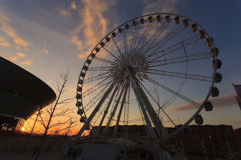 The Wheel of Liverpool. A modern day Ferris wheel at sunset a tourist attraction on the old Albert Dock, Liverpool stock images