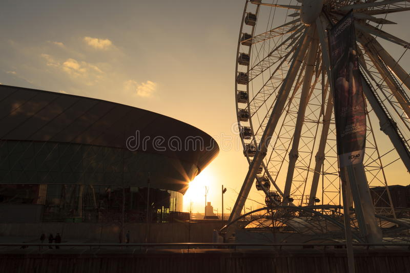 The Wheel of Liverpool. A modern day Ferris wheel at sunset a tourist attraction on the old Albert Dock, Liverpool royalty free stock photography