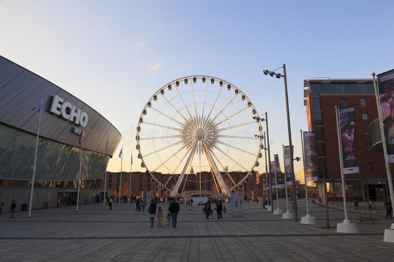 The Wheel of Liverpool. A modern day Ferris wheel at sunset a tourist attraction on the old Albert Dock, Liverpool royalty free stock photo