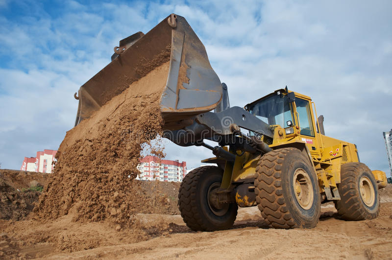 Wheel loader at eathmoving works stock photos