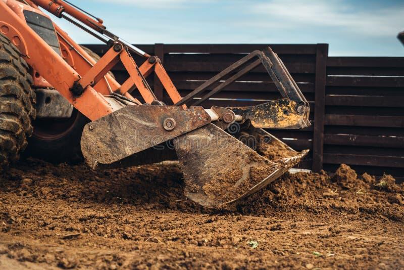 Wheel loader excavator, backhoe loader machinery details working on construction site royalty free stock image
