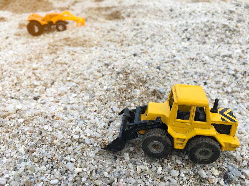 Wheel Loader excavator construction machinery equipment toy holding the sand royalty free stock image
