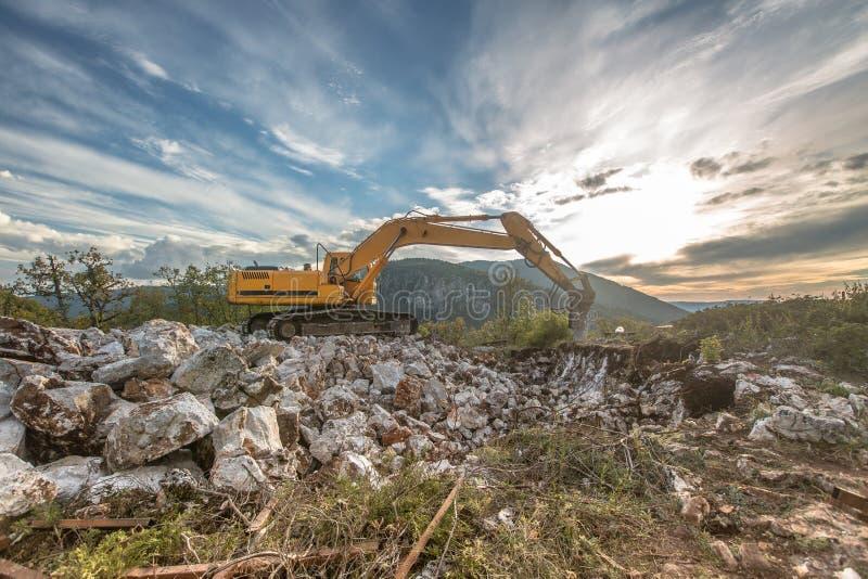 Wheel loader excavator at mountains work stock images