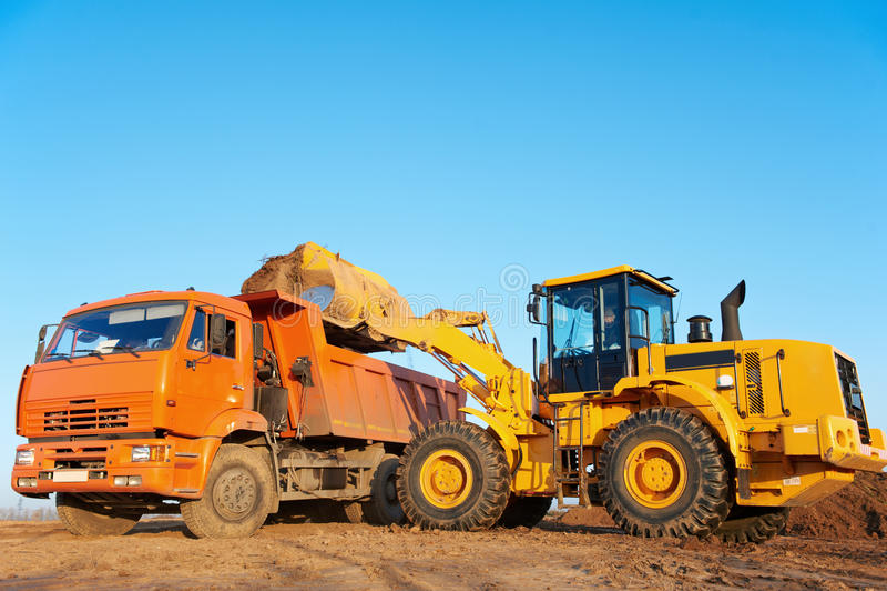 Wheel loader excavator and tipper dumper stock photography