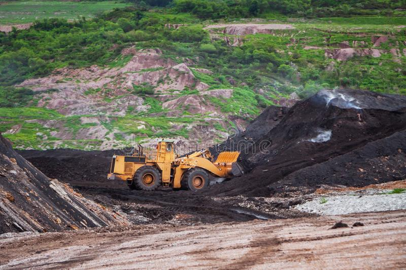 Wheel loader Excavator working moving and spread the soil stock photography