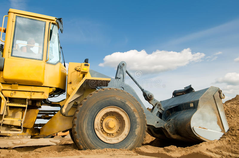 Wheel loader over blue sky stock photography