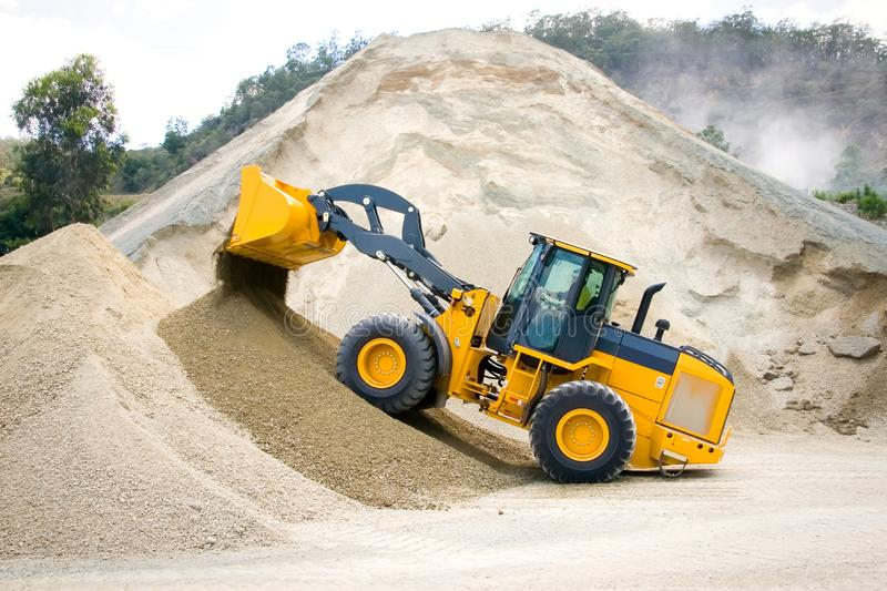 Yellow Wheel Loader at Aggregate Rock Quarry royalty free stock image