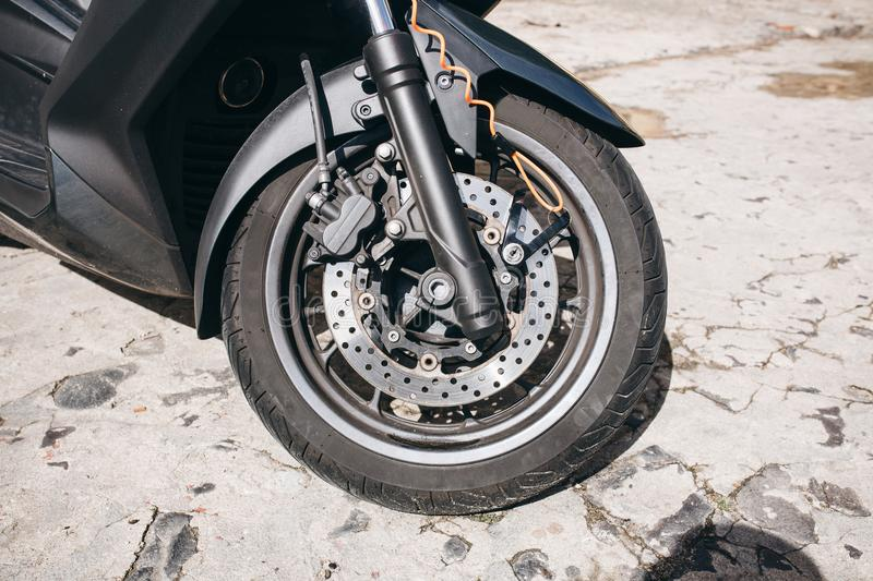 Wheel of motorcycle or scooter or moped. Brake system and spare parts for bike. Wheel of motorcycle or scooter or moped. Autotire or tire and design of wheel of stock photos