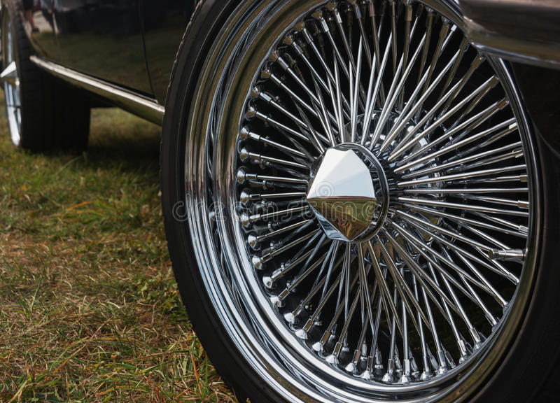 Wheel of an old sports car stock photography