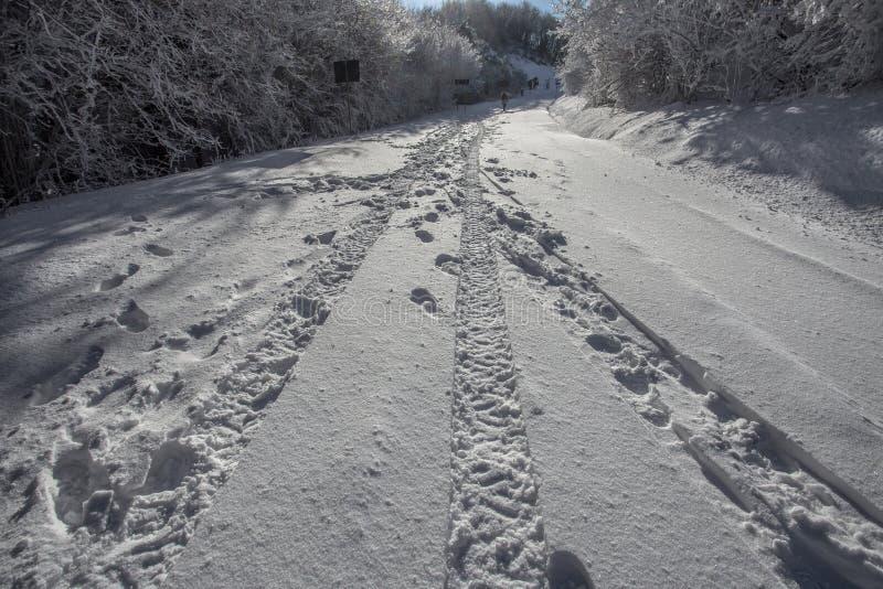 Wheel print in the snow/road/street/snow. Wheel print in the snow/road/street/snow/winter/white stock photo
