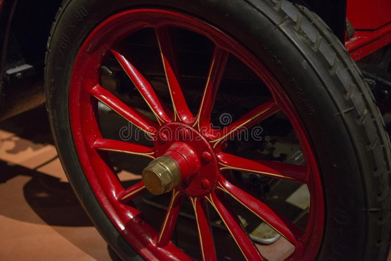 1906 Renault Type AX Old Fashioned Car Wheel. The wheel of a 1906, Renault produced approximately 2200 cars and opened their first U.S. market dealership in New royalty free stock image