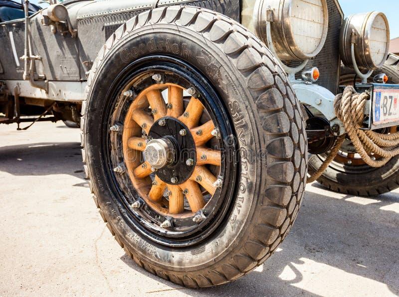 Wheel of a retro car American La France Tourer 1917 year. SAMARA, RUSSIA - JUNE 16, 2014: Wheel of a retro car American La France Tourer 1917 year stock photography
