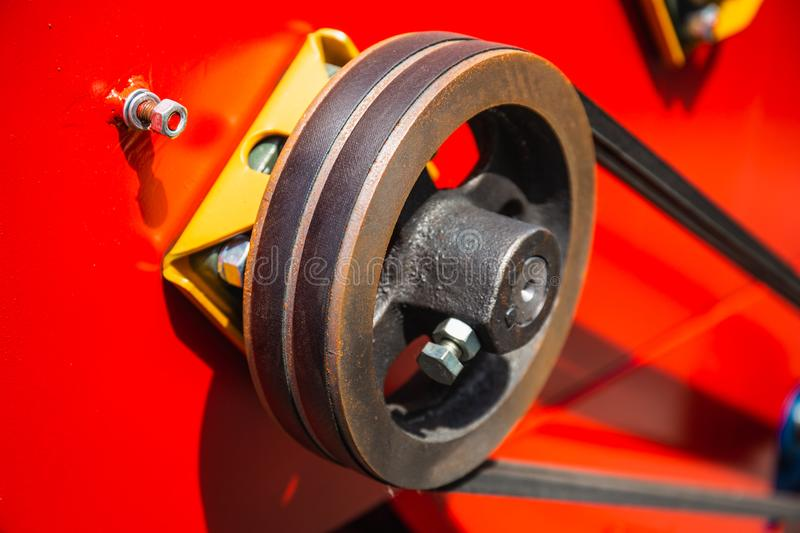 Wheel roller mechanism with strap timing belt on industrial vehicle machinery royalty free stock photos