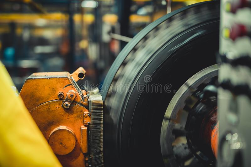 Wheel on a tire machine. Wheel on a tire scraping machine stock images