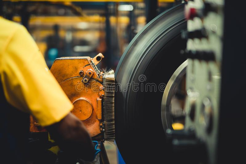 Wheel on a tire machine. Wheel on a tire scraping machine royalty free stock photos