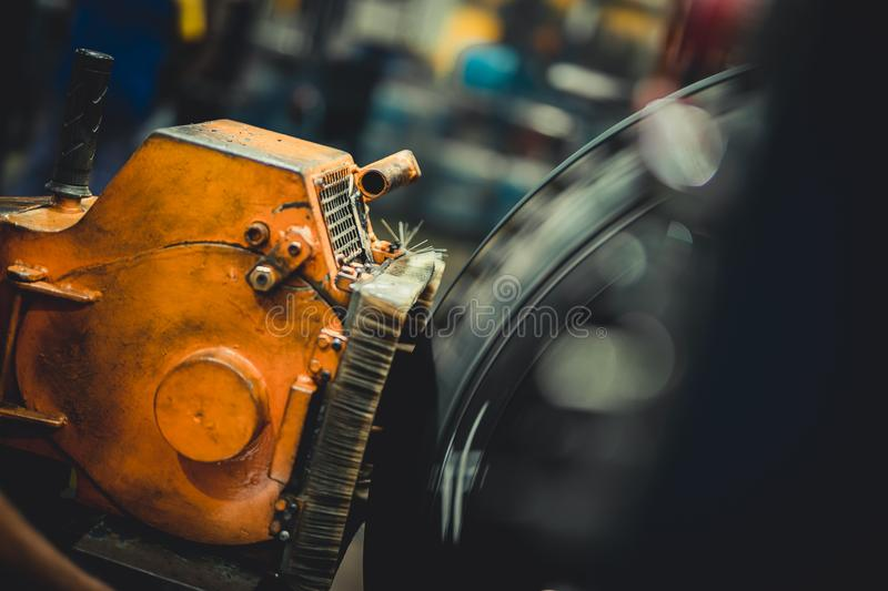 Wheel on a tire machine. Wheel on a tire scraping machine royalty free stock image