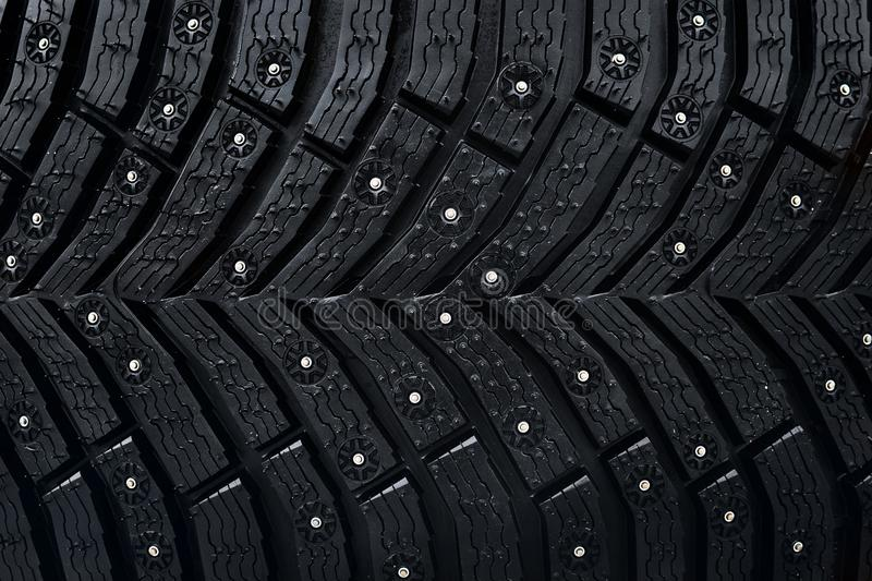 Wheel tire seamless pattern. A close up of a tire protector and studs. Winter tyre texture. Realistic illustration. Black rubber, stock photos