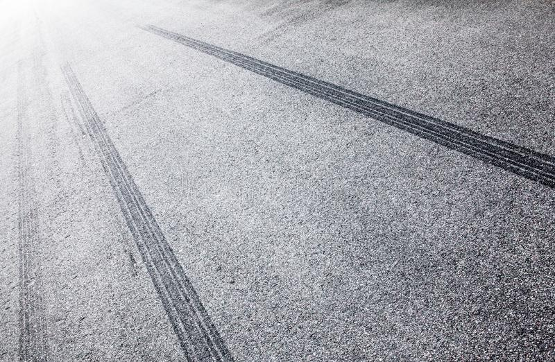 Wheel tracks on the road covered with hoarfrost royalty free stock images