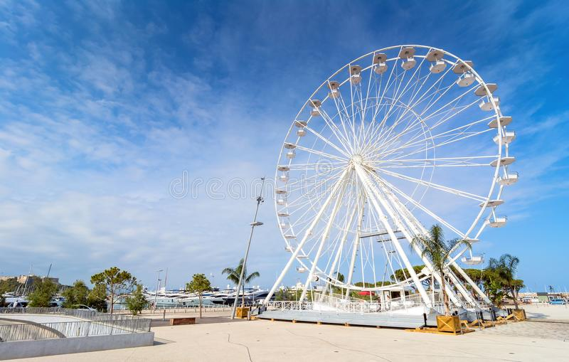 Wheel and Vauban port in Antibes. Antibes, France - July 01, 2016: day view of port Vauban and grande roue in Antibes, France. Port Vauban is the largest marina stock images