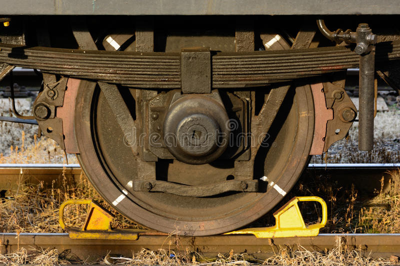 Wheel from a wagon. Old railway wagon, old forgotten train stock photography