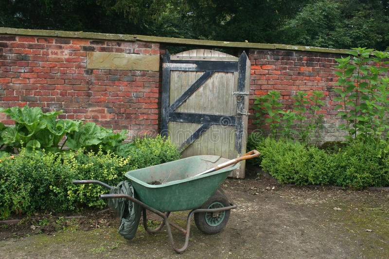 Download Wheelbarrow by gate stock image. Image of gate, beauty - 10426113