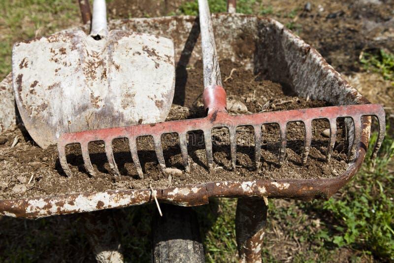 Wheelbarrow, Shovel And Rake Royalty Free Stock Images