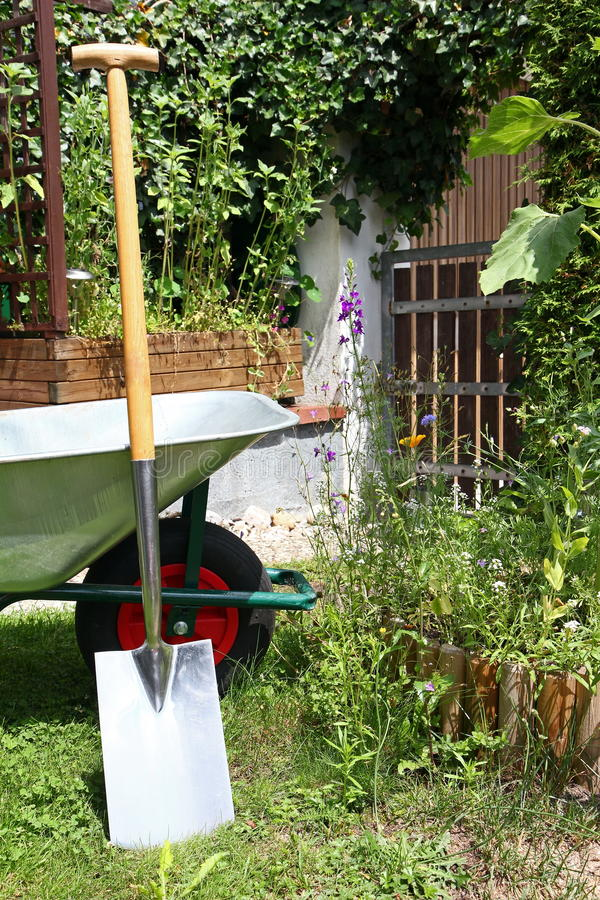 Download Wheelbarrow and spade stock photo. Image of gardening - 20291898