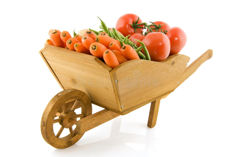 Wheelbarrow with vegetables stock photos