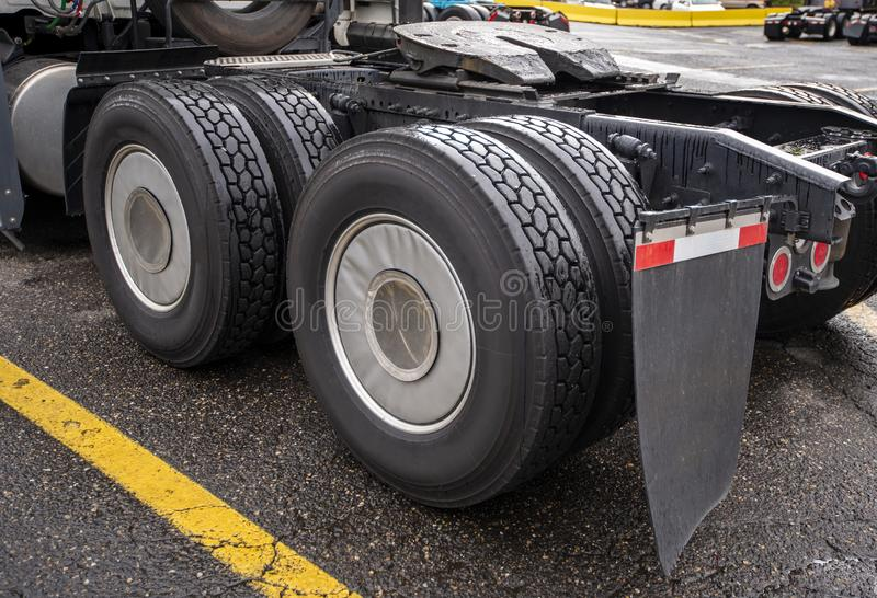 Wheelbase of big rig semi truck with two axles and pairs of wheels on them and fifth wheel for coupling stock images