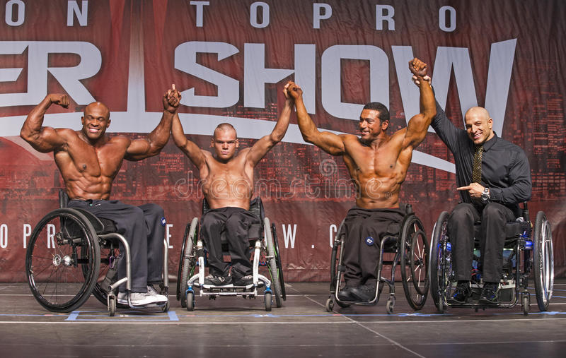 Wheelchair Athletes Pose in Toronto. Braden Hoffman center, an 18-year-old wheelchair athlete joins competitors Harold Kelley of USA winner,left and Antoni stock photos