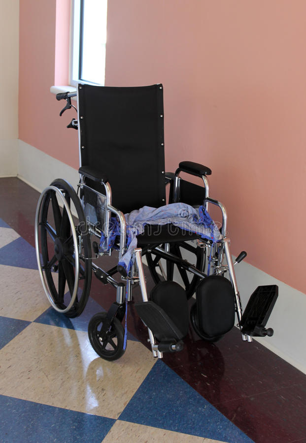Runaway Patient. Empty wheelchair with patient's robe on the seat... a runaway patient stock images