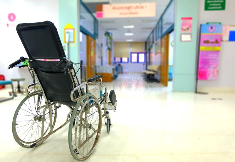 Wheelchair in front of the examination room in hospital stock image