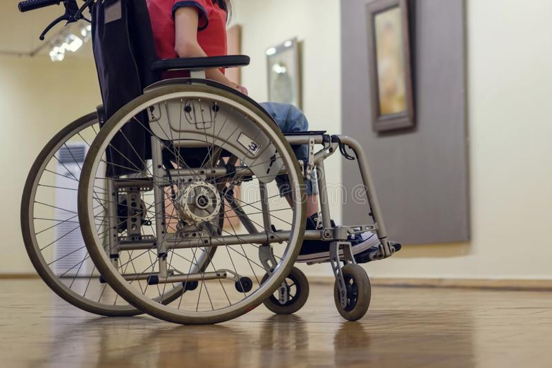 Wheelchair. Girl in a wheelchair at the art gallery royalty free stock photography