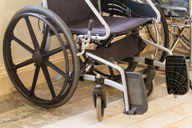 Wheelchair in a hospital corridor for physically disabled patients. No people. Healthcare equipment. Wheelchair in a hospital corridor for physically disabled stock photo