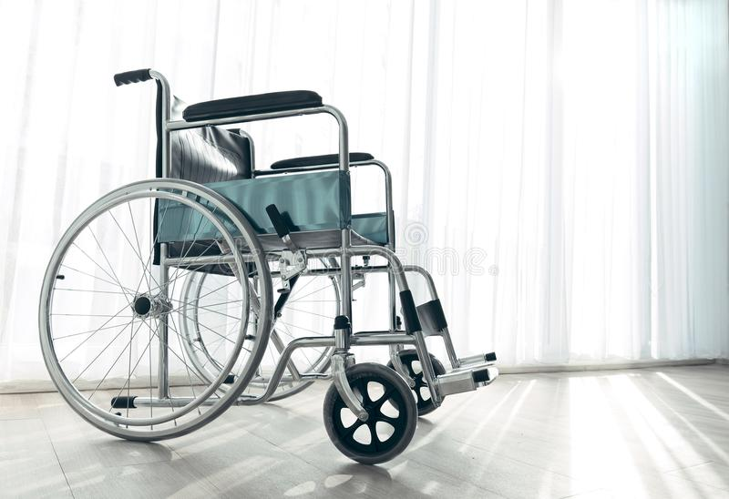 Wheelchair parking in the hospital room with sunlight in background, concept for the health care of the elderly or the disabled. Wheelchair parking in the stock image
