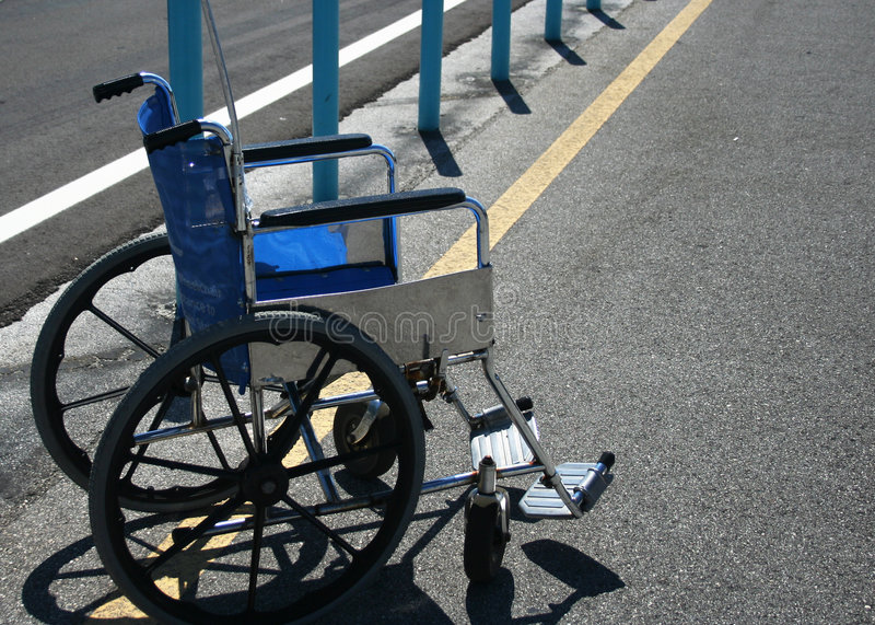 Download Wheelchair in parking lot stock photo. Image of help, handicapped - 773724
