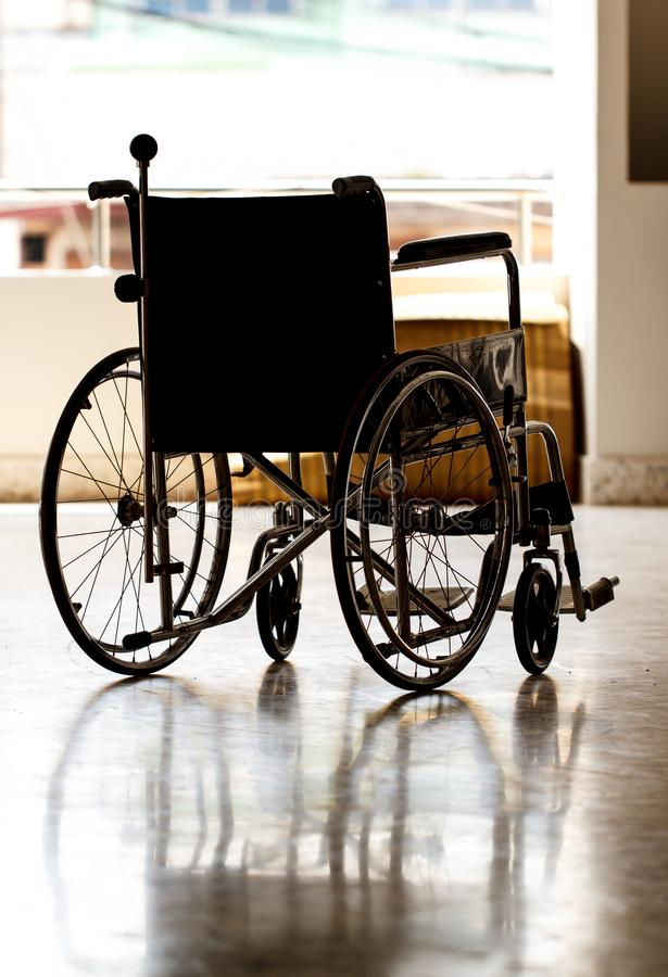 Wheelchair in a hospital ward stock images